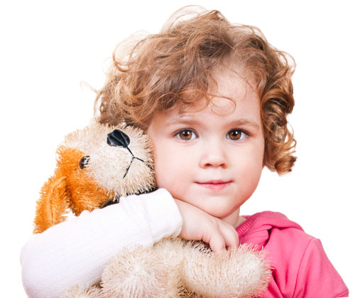 girl hugs plush dog